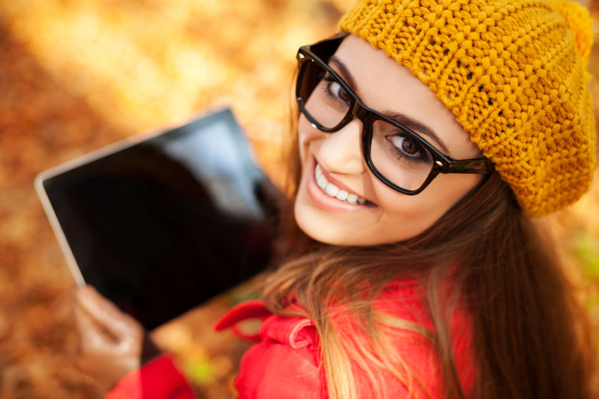 High school girl smiles with tablet